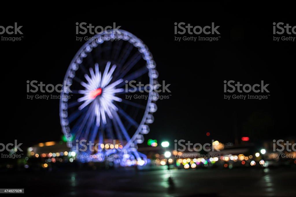 Blurred light of ferris wheel in Bangkok stock photo