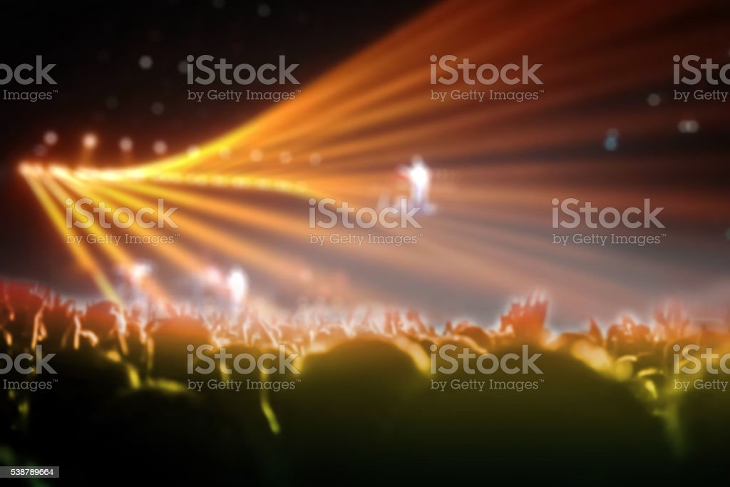 blurred lighting in concert with cheering audience stock photo