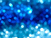 Blurred lights effect on a blue and white background