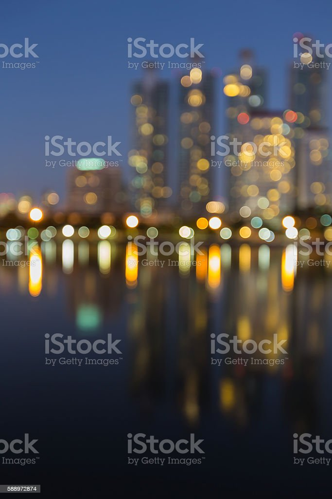 Blurred lights office building with water reflection night view stock photo
