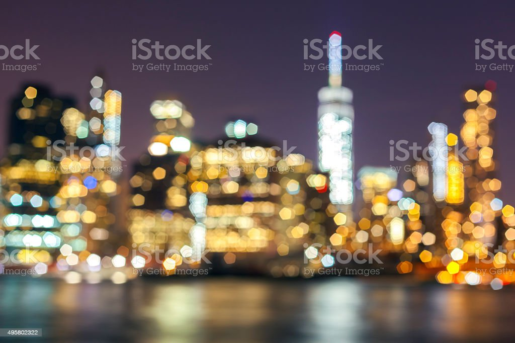 Blurred Manhattan waterfront at night, NYC, USA. stock photo