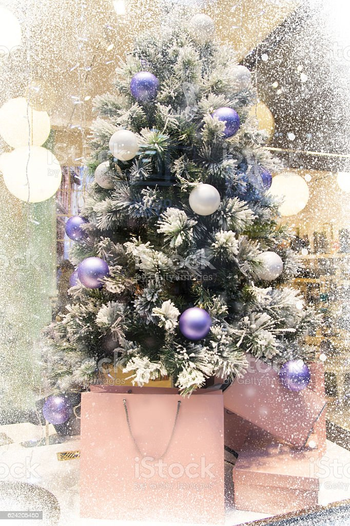 blurred many purple and white Christmas balls on the Christmas tree stock photo