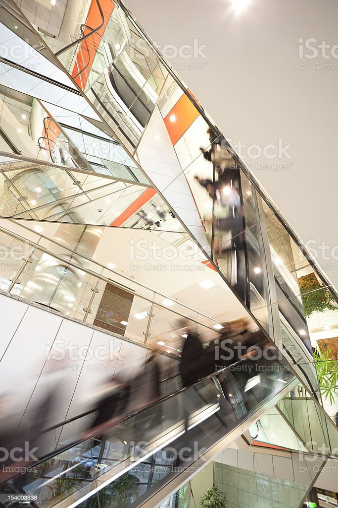 Blurred motion abstract of people on escalator stock photo