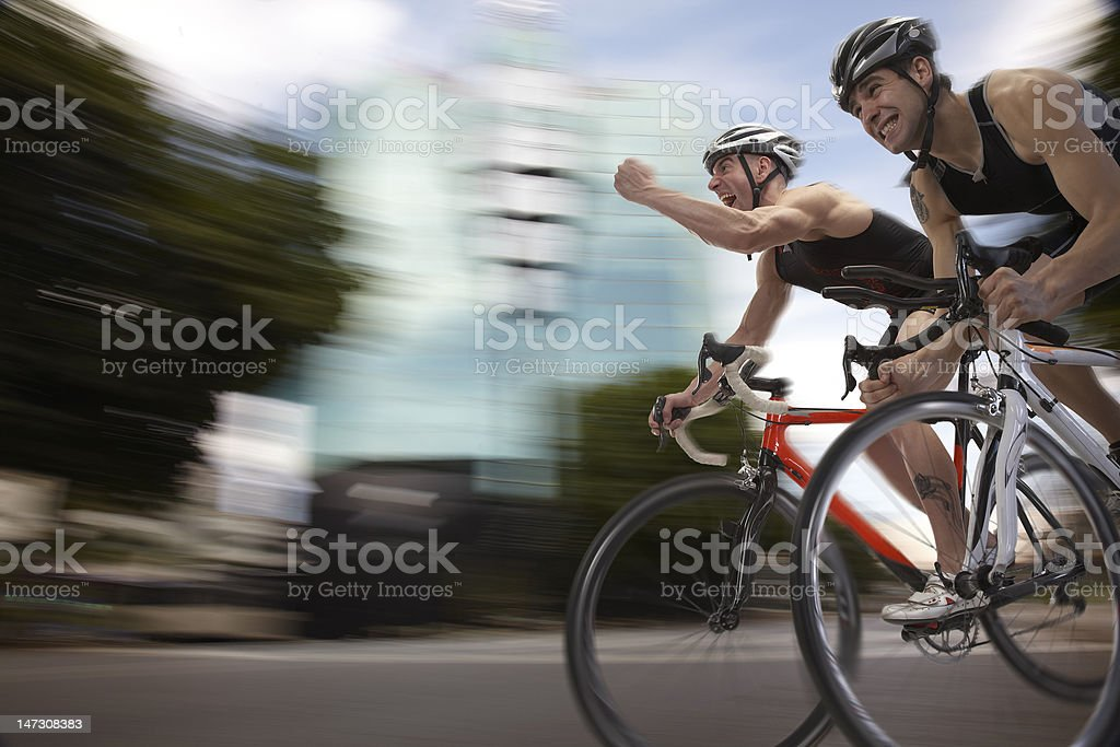 Blurred motion bicycle race finalist at finish stock photo