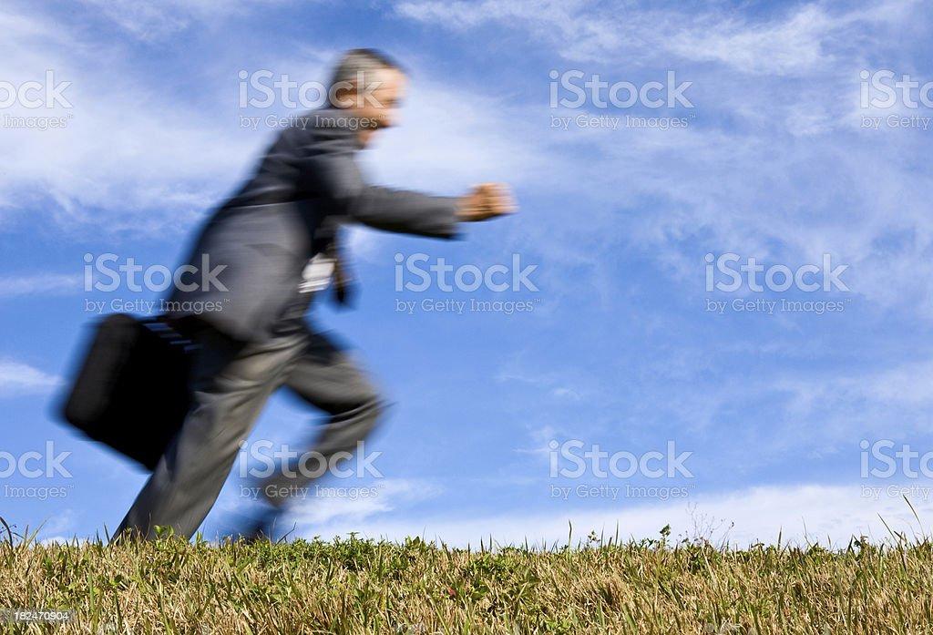 Blurred motion businessman running royalty-free stock photo