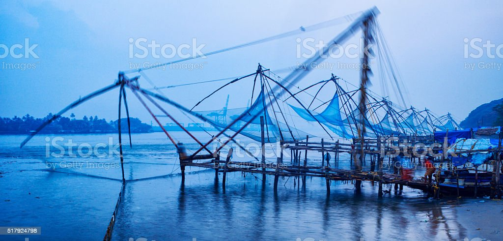 Blurred motion Chinese fishing nets at sunrise in Kochi, India stock photo