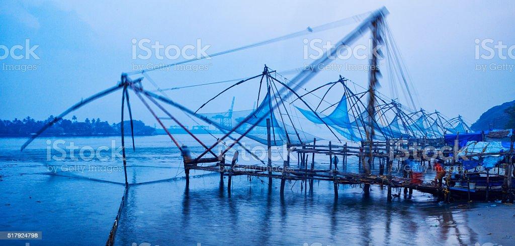 Blurred motion Chinese fishing nets at sunrise in Kochi, India stock photo