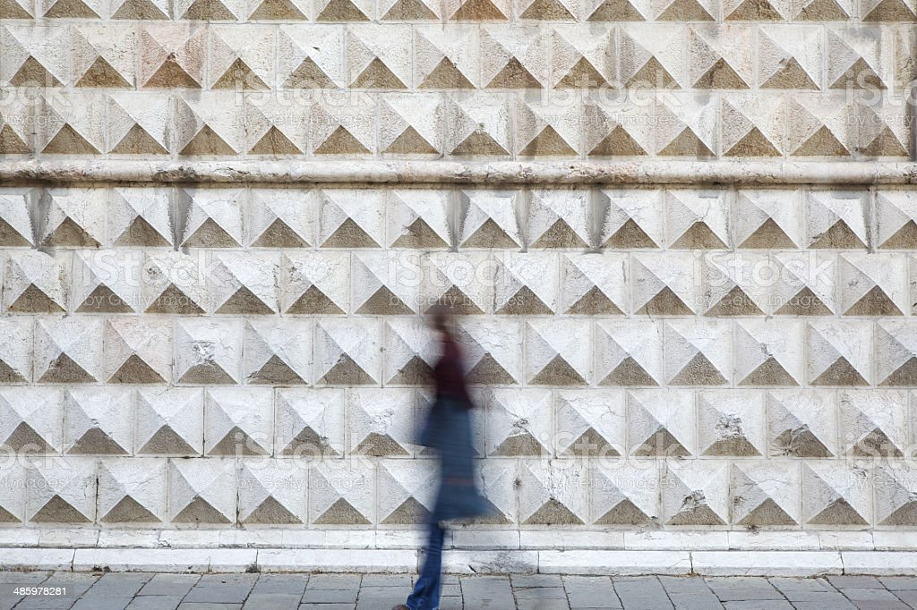 Blurred motion in front of 'Palazzo dei Diamanti'. Ferrara-Italy. stock photo