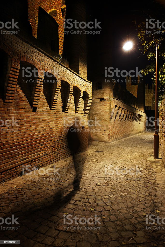 Blurred Motion of a Man in Medieval Alley royalty-free stock photo