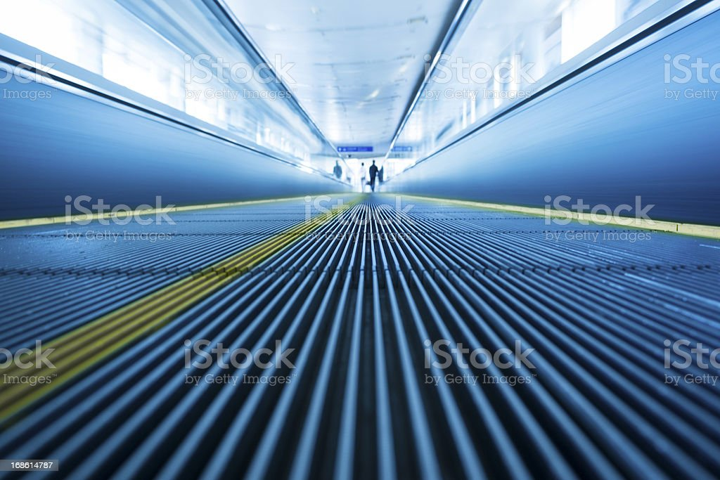 blurred motion of airport moving walkway royalty-free stock photo