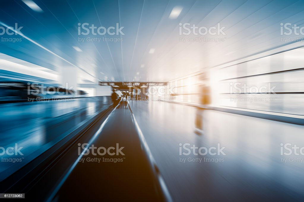 blurred motion of airport moving walkway stock photo