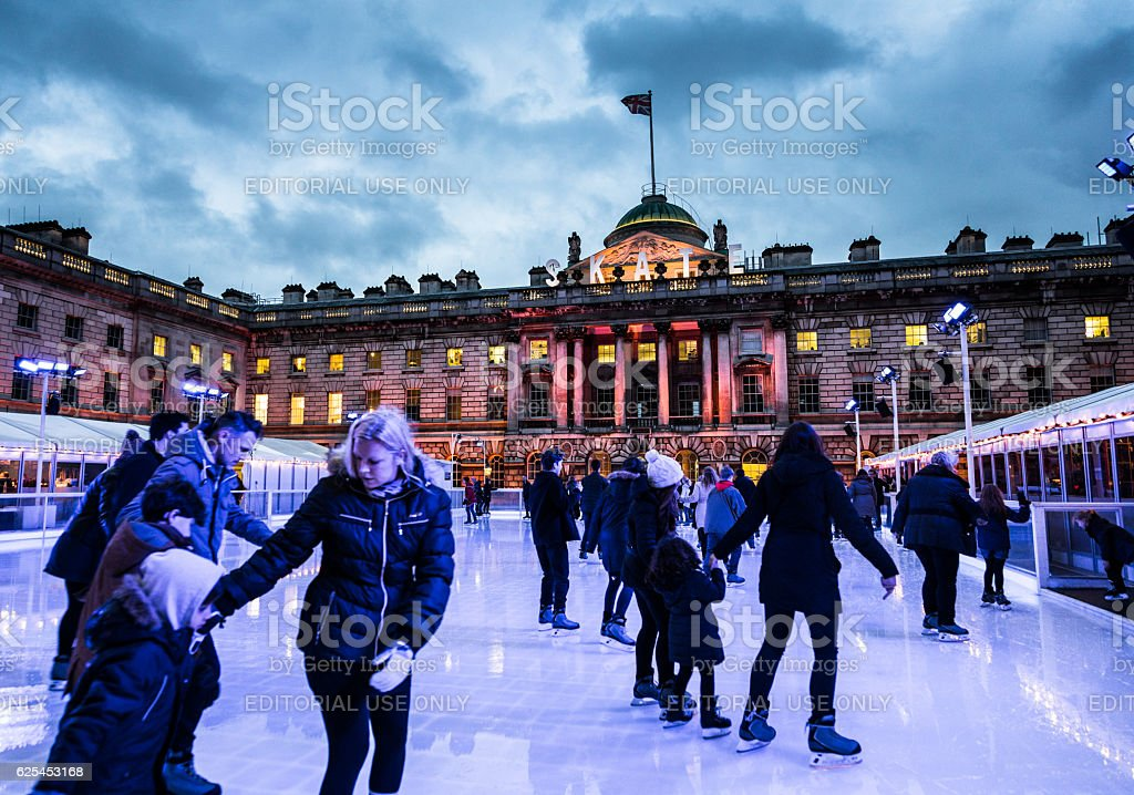 Blurred motion of People Ice Skating, Somerset House, London, UK stock photo