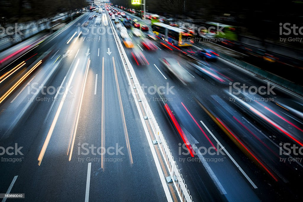 Blurred motion of traffic in the city at night stock photo