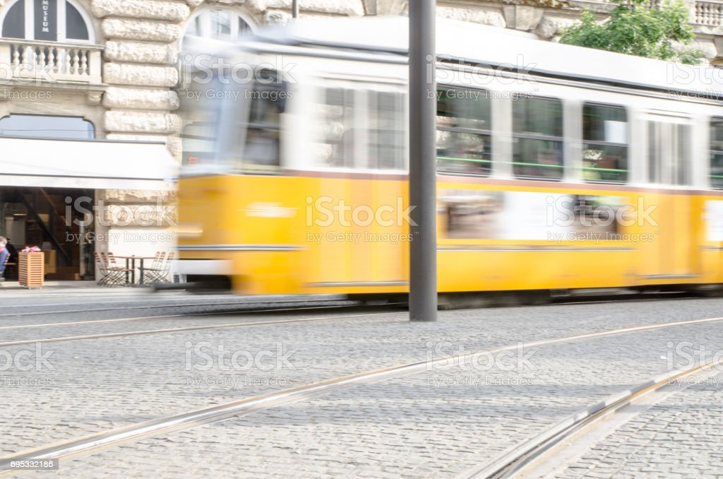 Blurred motion of Yellow tramway passing by on Buda side of Budapest stock photo