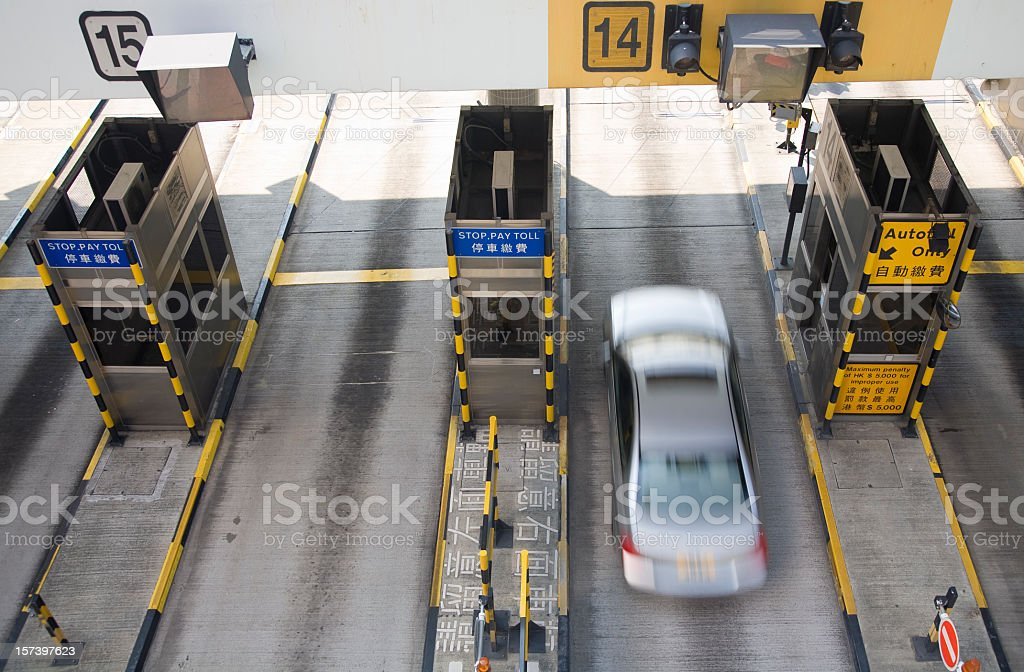 A blurred motion photograph of toll booths stock photo