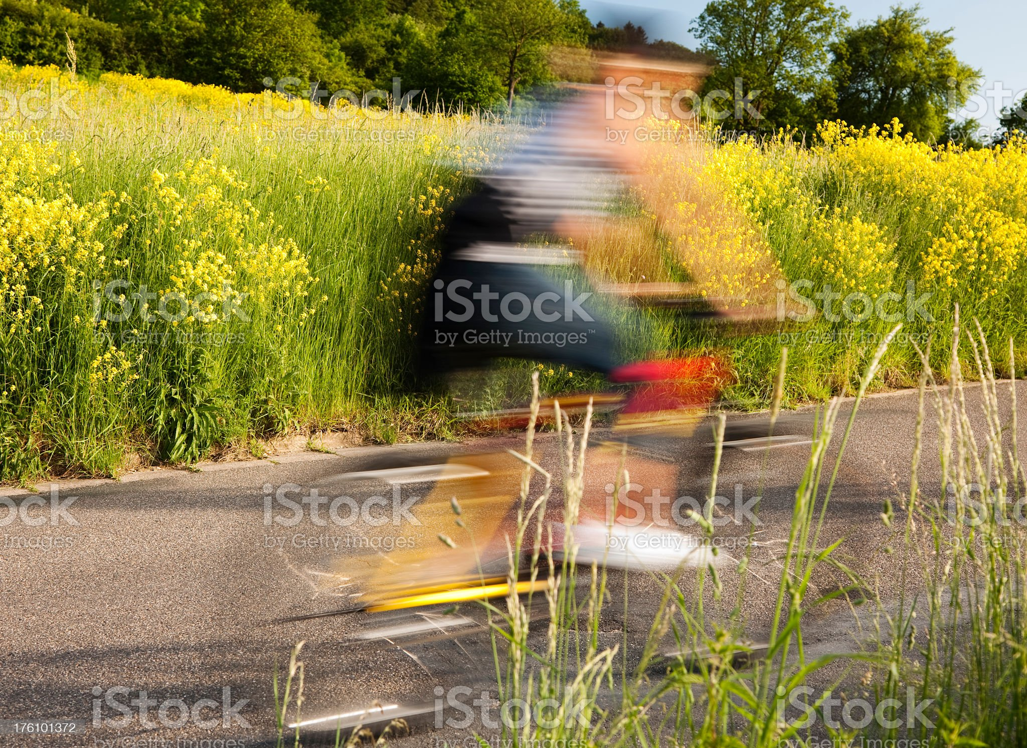 Blurred Mountain Biker Riding on Country Road royalty-free stock photo