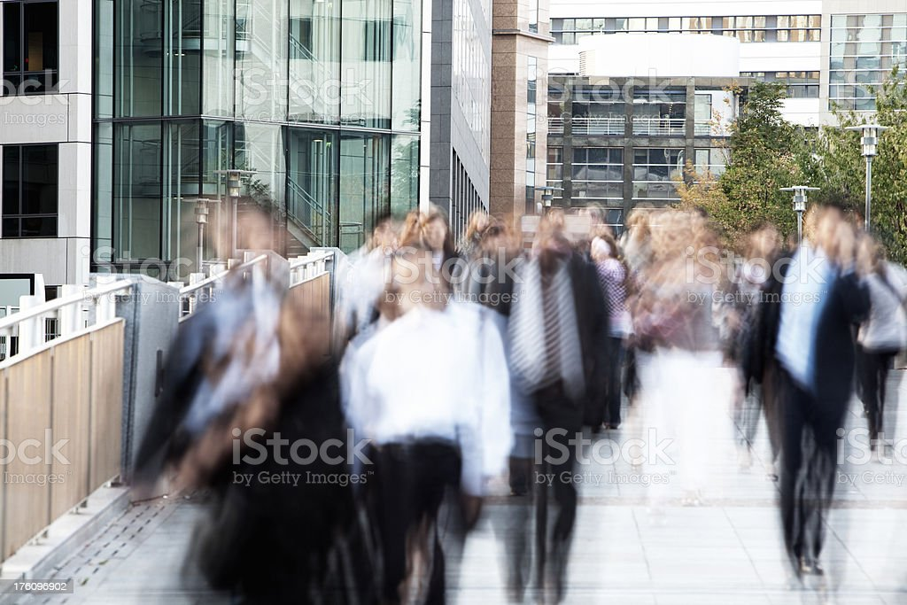 Blurred moving business people in a financial district royalty-free stock photo
