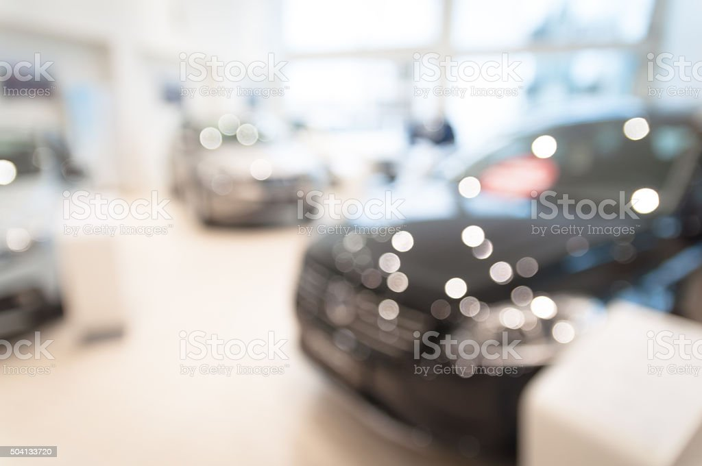 blurred  new cars dealership place stock photo