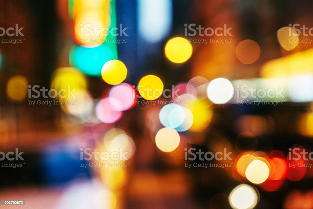 Blurred nighttime scene of a city stock photo