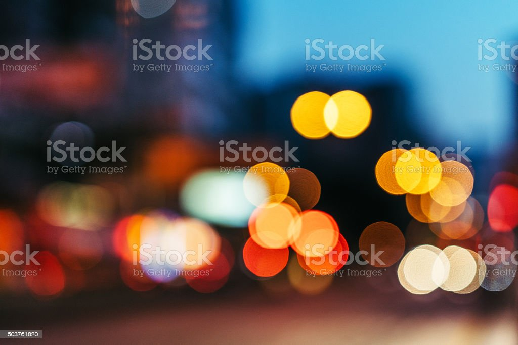 Blurred nighttime scene of a city stock photo