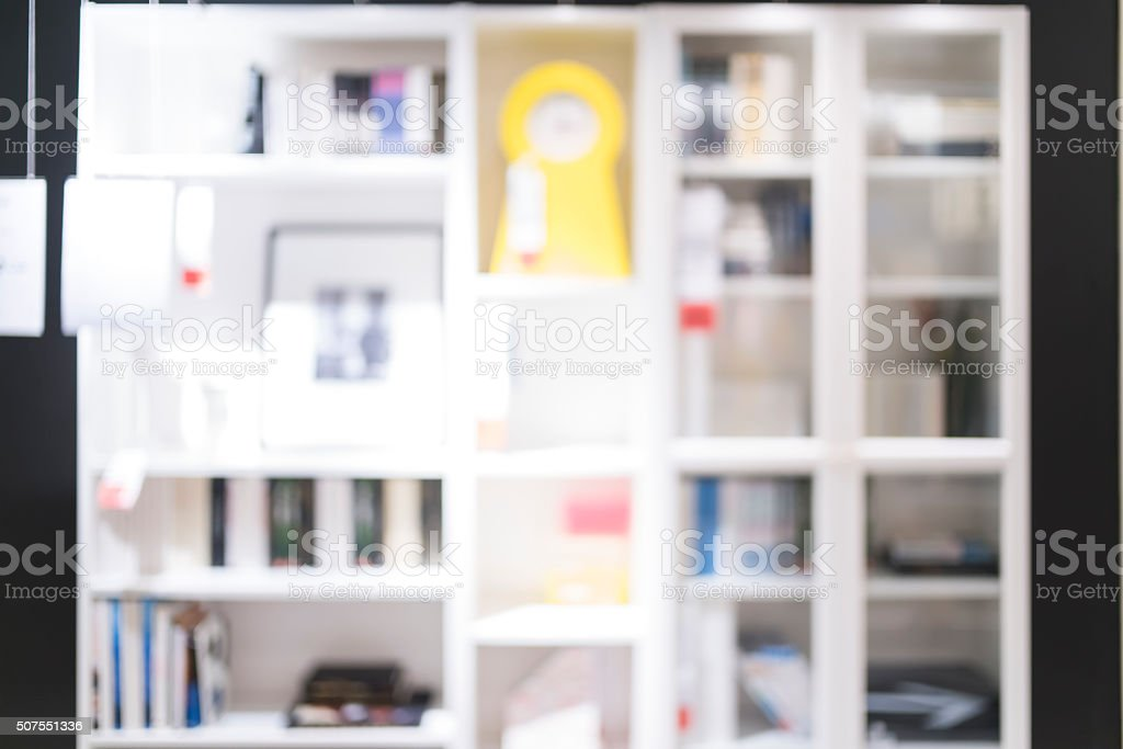 Blurred of bookshelf for backgrounds uses stock photo