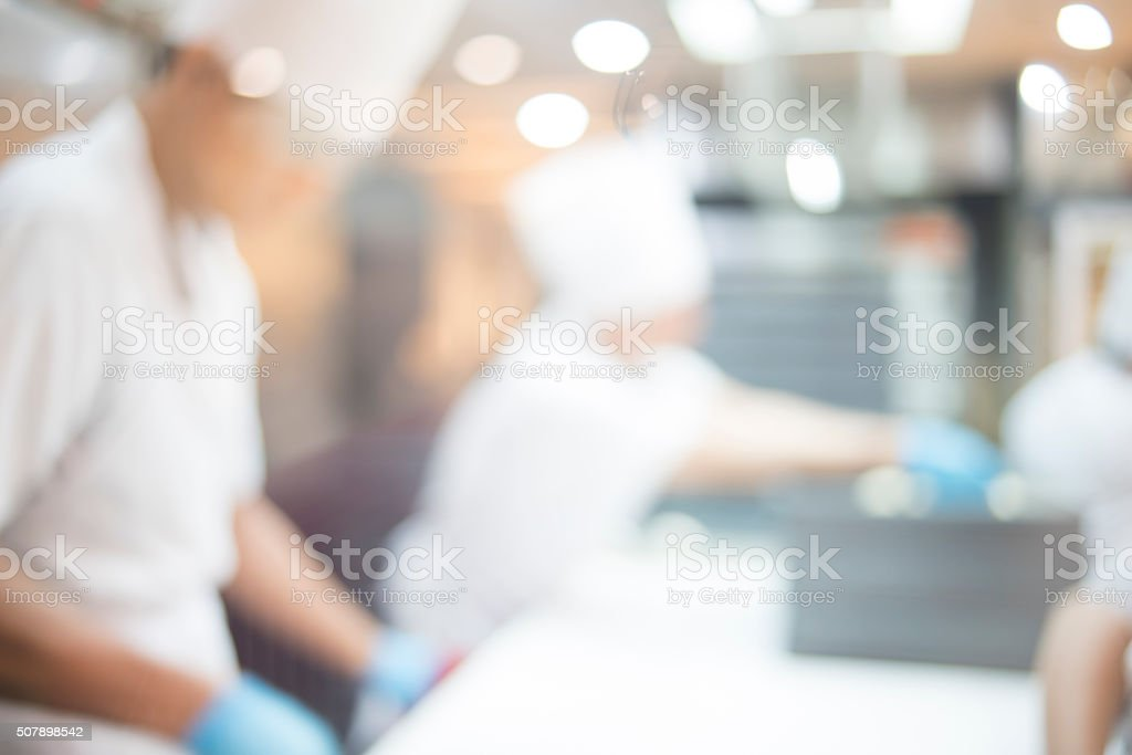 Blurred of Chef making baker in open kitchen stock photo