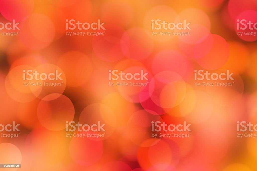 blurred orange and red dots stock photo