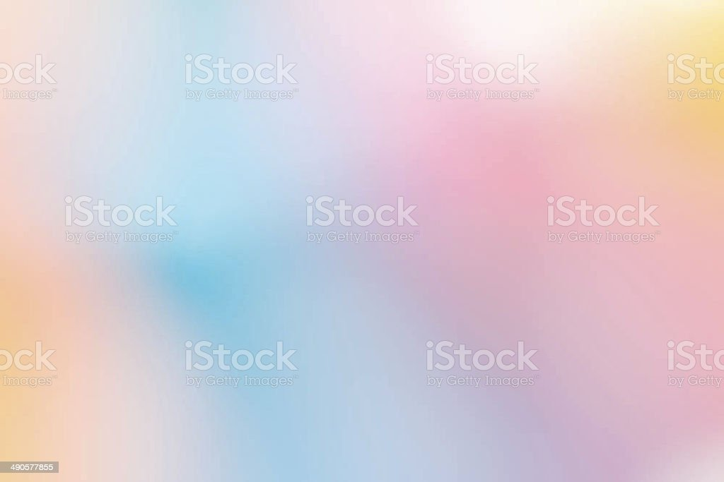 blurred pastel coloured background of blues and pinks and yellows stock photo