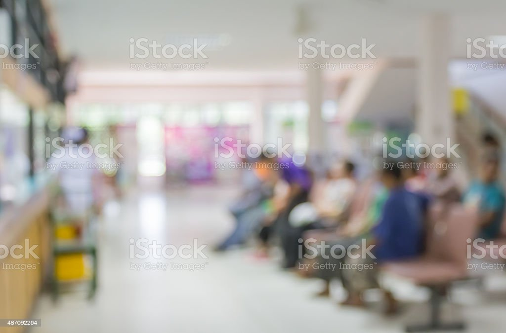 Blurred people and patient waiting doctor or medicine in hospital stock photo