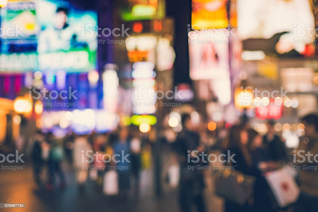Blurred people and shopping center in Dotonbori road stock photo