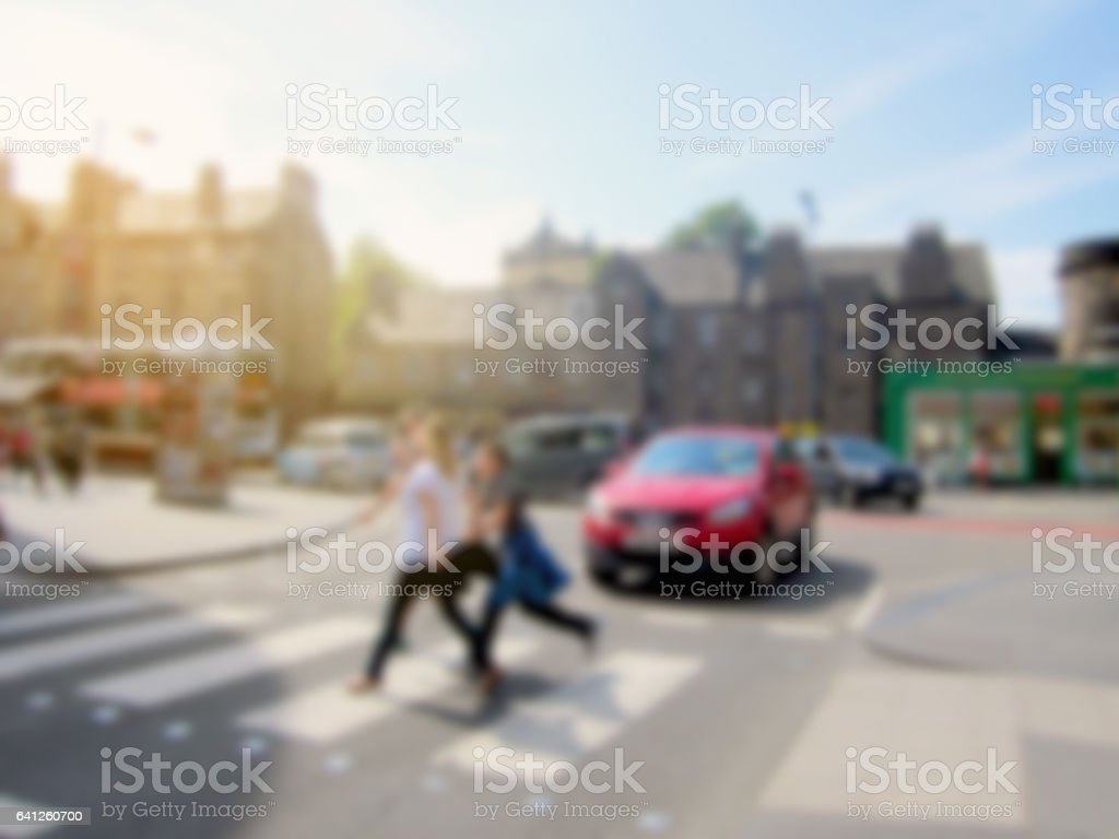 Blurred people crossing the road on zebra crossing stock photo