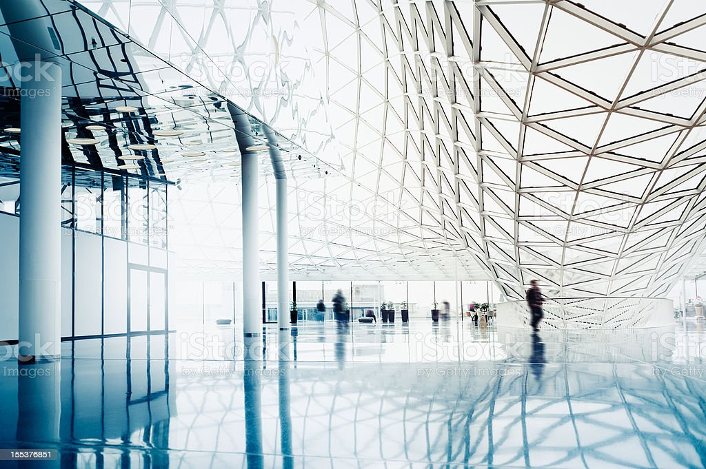 Blurred people entering modern architecture stock photo