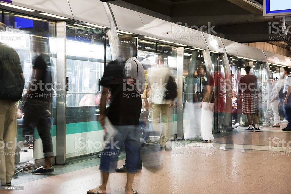 Blurred People Getting Into Subway Train During Paris Rush Hour stock photo