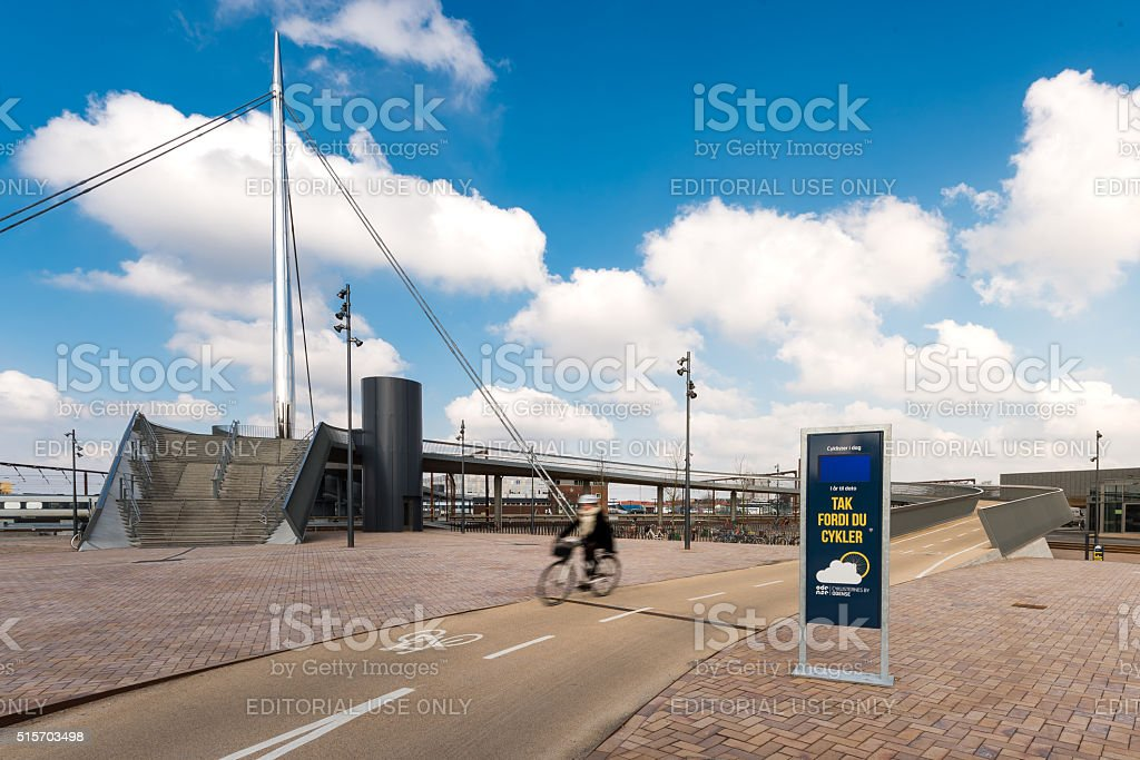 Blurred people going by bike in Odense, Denmark stock photo