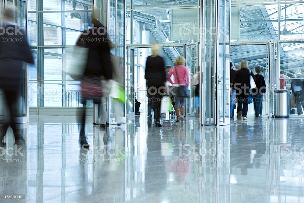 Blurred People in Corridor stock photo