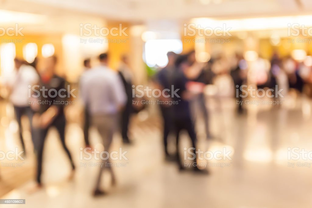 Blurred people in grand opening event hall, business concept. stock photo