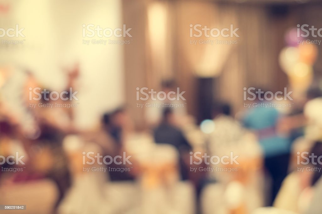 Blurred people in the banquet room stock photo