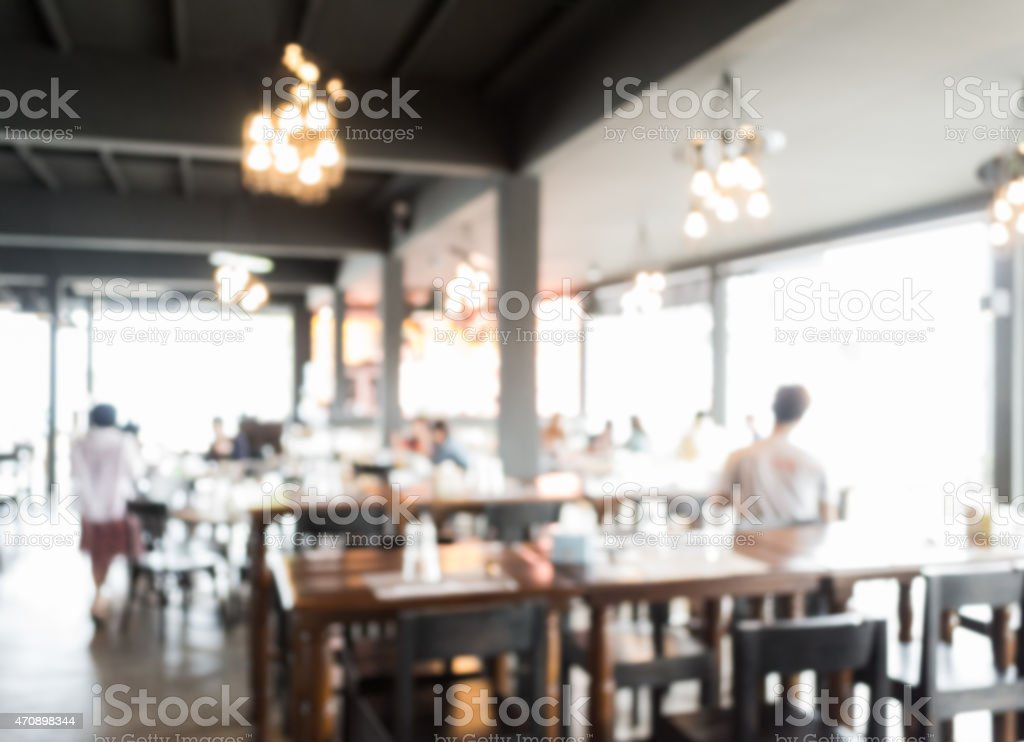Blurred people in the restaurant stock photo