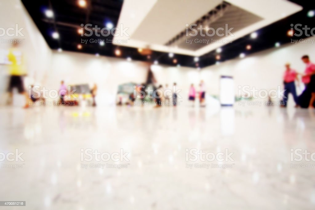 Blurred people inside modern building stock photo