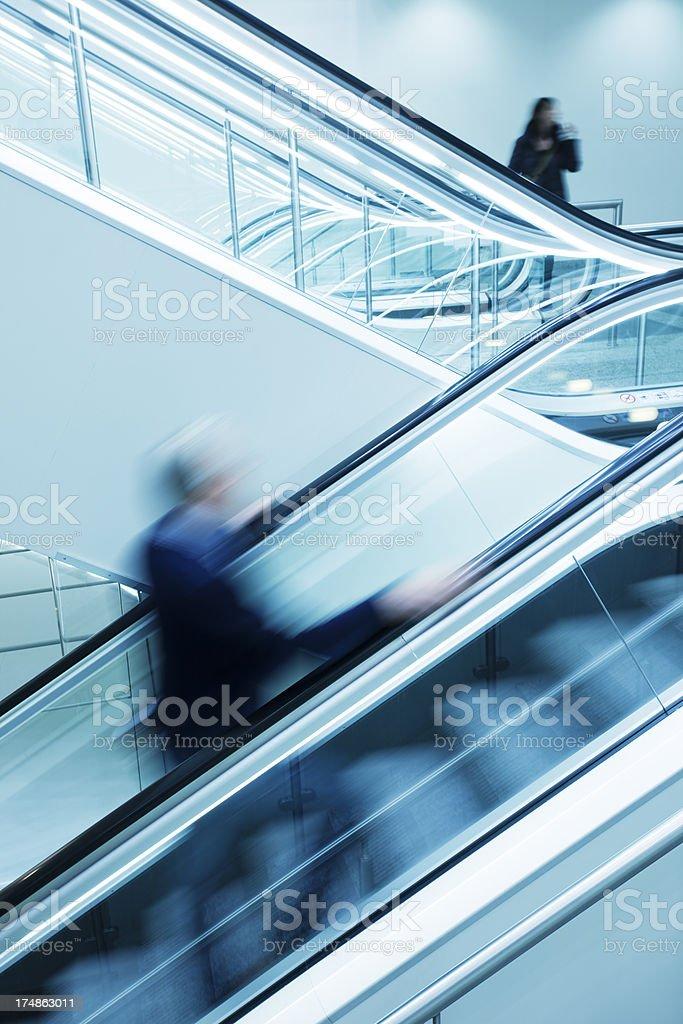 Blurred People on Escalators royalty-free stock photo