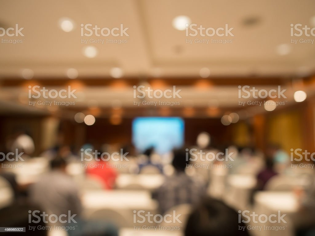 blurred people sitting rear at the business conference stock photo