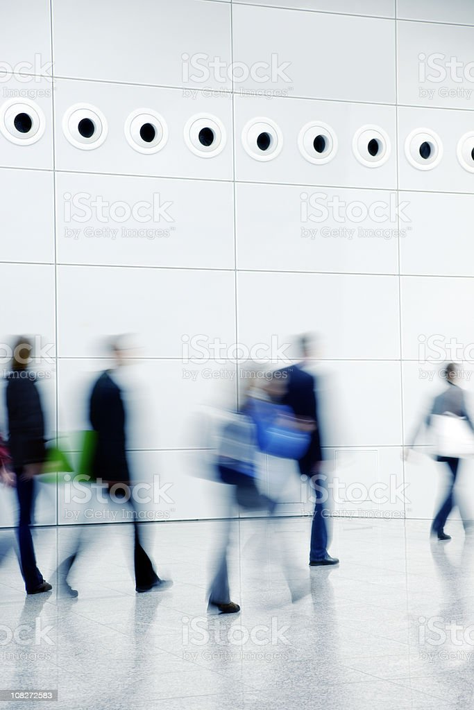Blurred People Walking Down a Hallway royalty-free stock photo