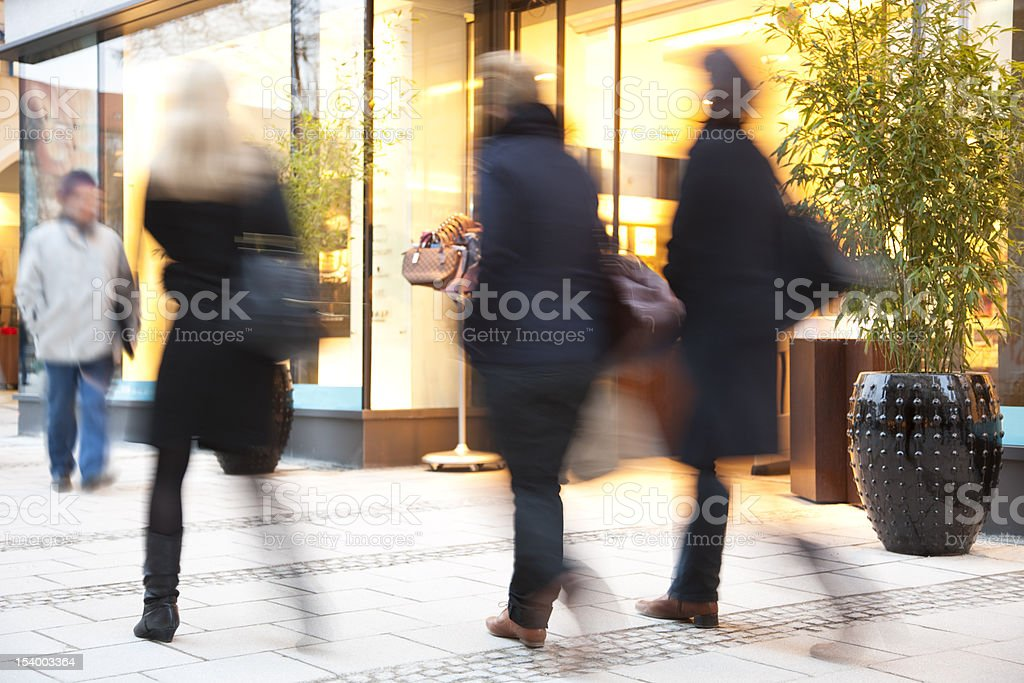 Blurred People Walking down Shopping Street royalty-free stock photo