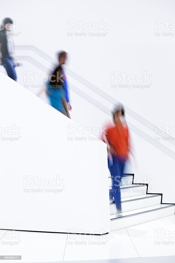 Blurred People Walking Down Stairs Indoors royalty-free stock photo