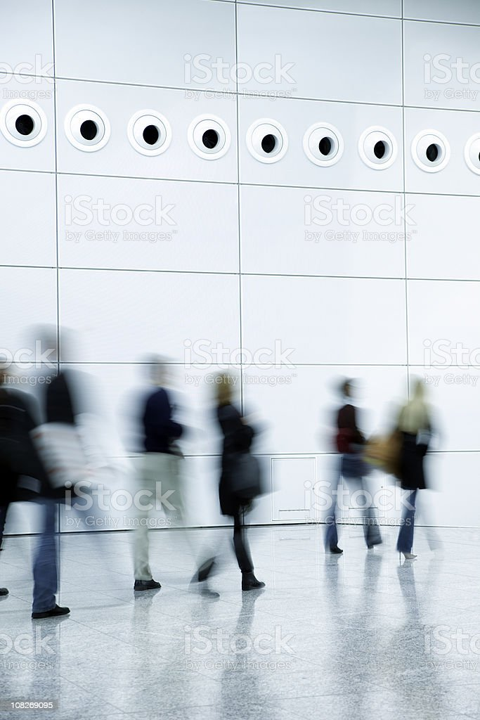 Blurred People Walking in a Modern Interior royalty-free stock photo