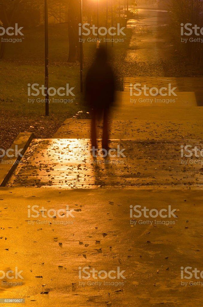 blurred person silhouette in dark stock photo