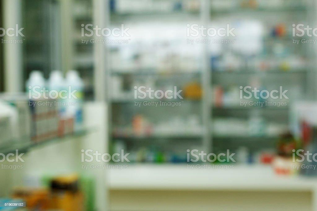 Blurred pharmacy drugstore shelves and counter stock photo