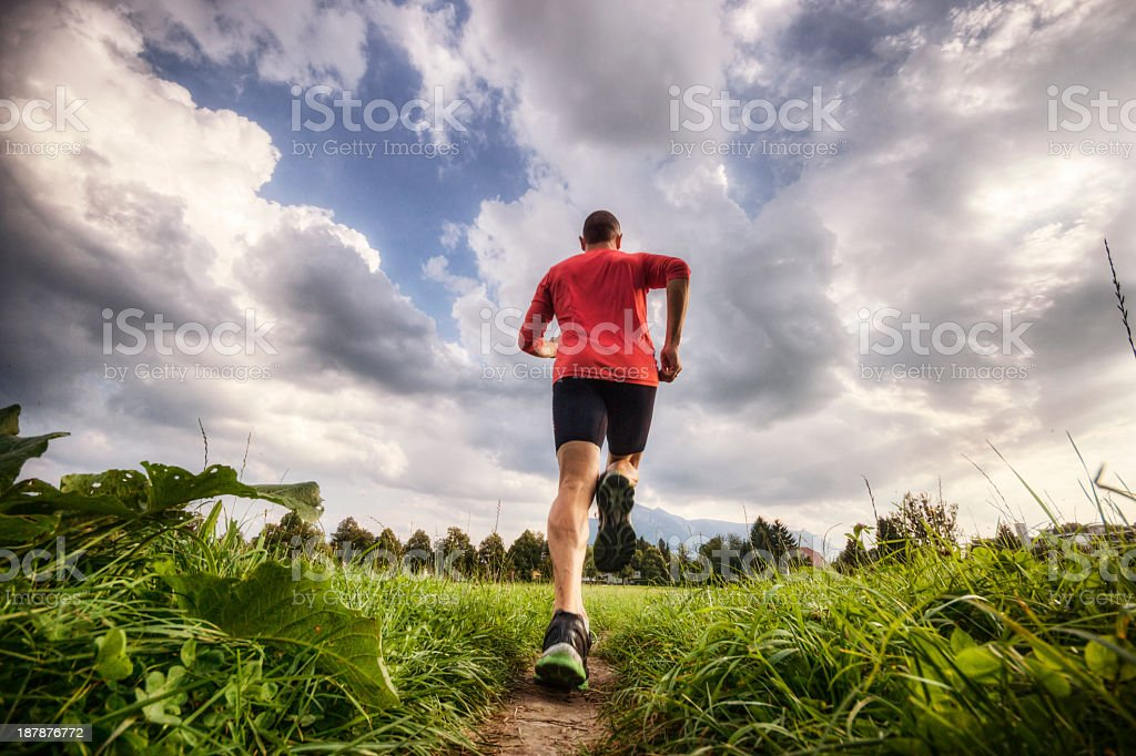 Blurred photo of a runner training in a green surrounding  stock photo