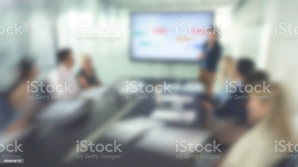 Blurred photo of an analyst presenting her work stock photo