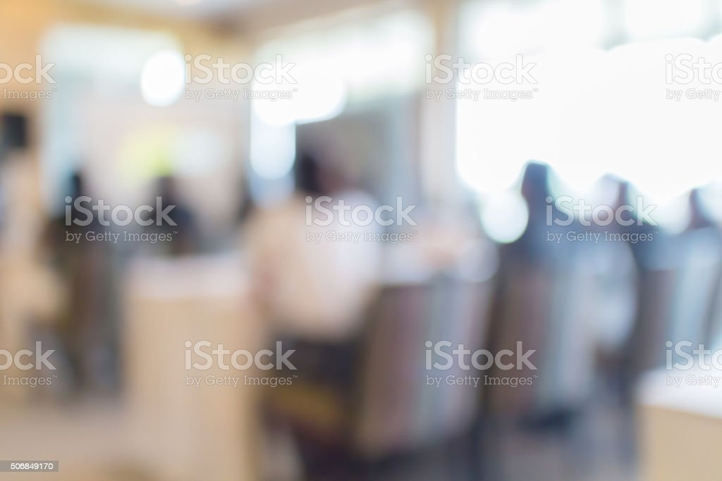 Blurred photo of audience group attending  in conference meeting stock photo